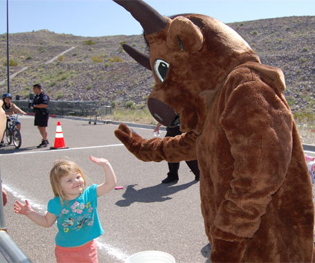 Toddler high fives Bullhead Mascot