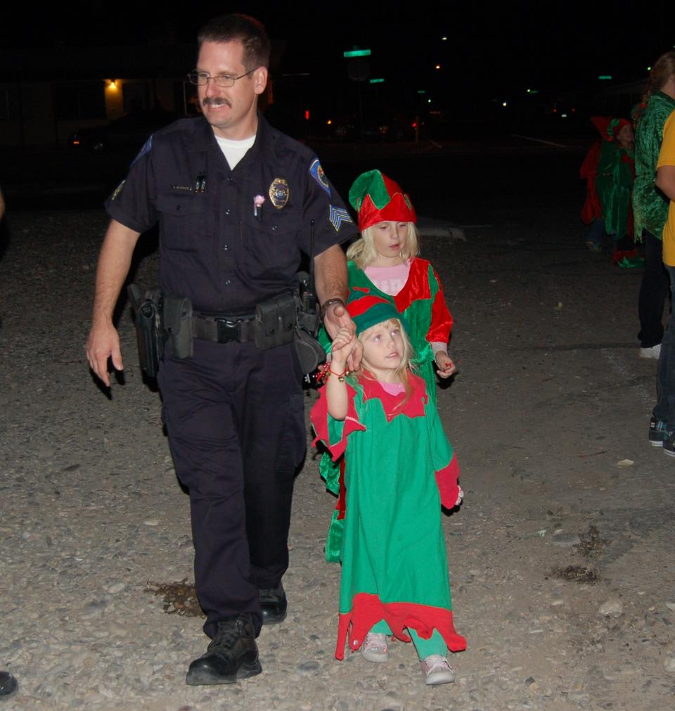 Police officer with elves